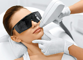Woman getting painless quick Laser Hair Removal on upper lip